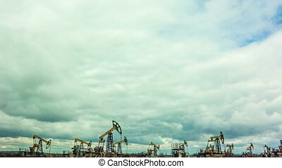 Working Oil Pumps at blue sky time lapse - Working Oil...