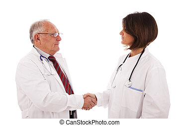 Doctors deal - handshake of a team of doctors (isolated on...