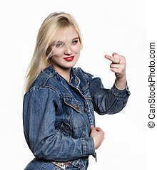 Sporty girl in denim jaket and jeans show middle finger,...