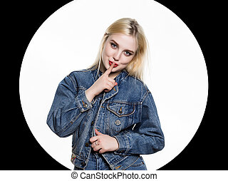 young blonde woman in denim jaket and jeans shows Index...
