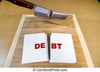 Cutting Debt - Cutting debt with a cleaver and cutting...