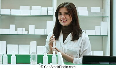 Friendly pharmacist with bottle of pills talking to camera....