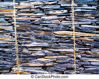 The walls made from overlapping of sedimentary stone - The...
