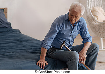 Unhappy cheerless man sitting on the bed - Empty space....