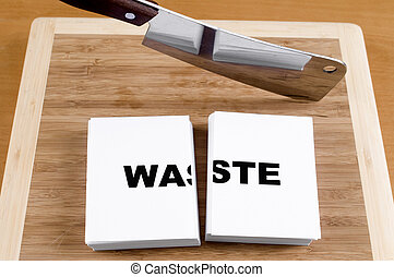 Cutting Waste with a Cleaver and Cutting Board.