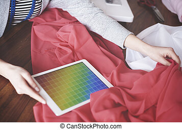 Fashion designer matching colors with textile