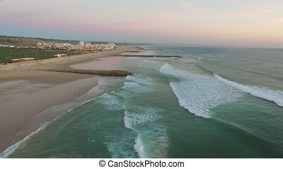 Aerial videoin motion during sunset in the Atlantic Ocean in...