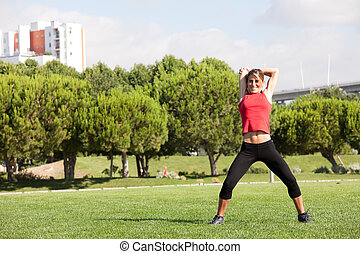 Woman exercising at the park