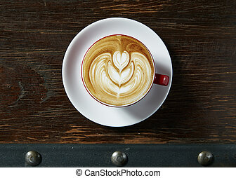 Cup of art latte or cappuccino coffee