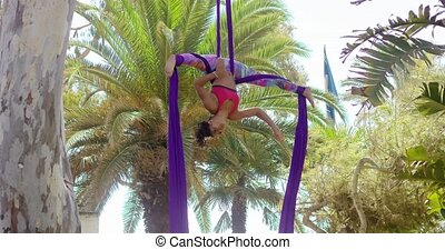 Young gymnast working on her acrobatic dance