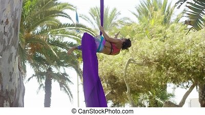 Agile athletic young acrobatic dancer hanging gracefully...