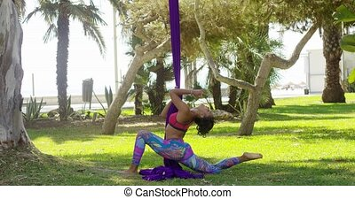 Young gymnast working out with ribbons - Young gymnast...
