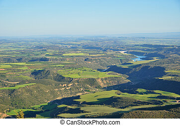 Spring view of the Spanish plain with a river in the canyon, Hoya de Huesca