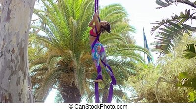 Agile young gymnast working out on ribbons practicing an...