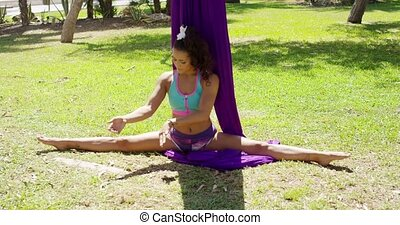 Graceful acrobatic dancer working out doing stretching...