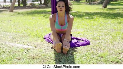 Young gymnast working out in a park doing the splits...