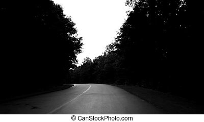 Long curving road. Spooky. - Long curve on a rural road....