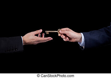 Business solution - Hand offering a key