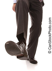business step - shoe and leg of a businessman caution step...