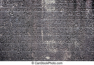 Ancient sanskrit text carved in stone - Background of...