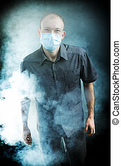 young doctor in a mask in smoke