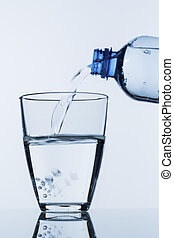 pour water into a glass - water is poured into a glass out...