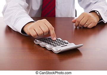 Accountant businessman - businessman using his calculator at...