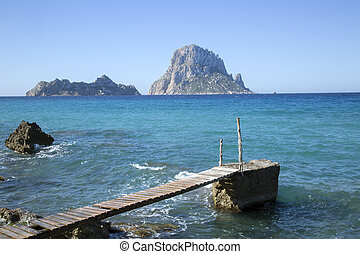 Pier at Hort Cove and Beach with Vedra Island; Ibiza, Spain