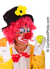 funny clown holding color balls isolated on white