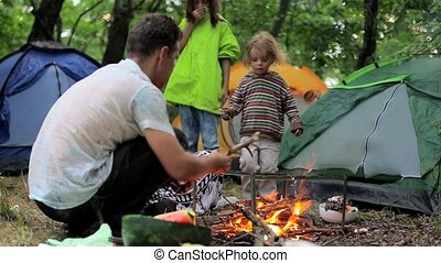 Bonfire night in a tent camp in the countryside.
