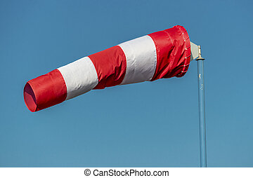 windsock against a blue sky - a windsock inflated by the...
