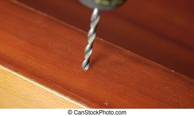 man drill hole in a wooden board - Man drill hole in a...