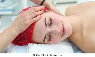 Cosmetic medicine, massage. - Young beautiful girl getting...