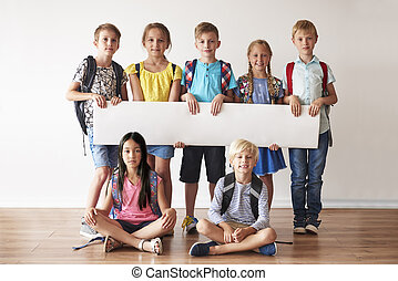 School friends with white placard