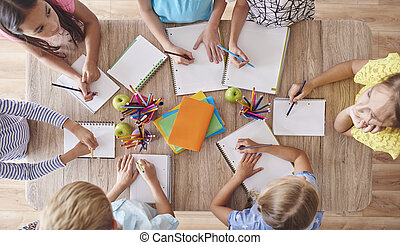High angle view of drawing kids