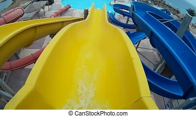 slide on a yellow pipe at Aqua Park Egypt Hurgada