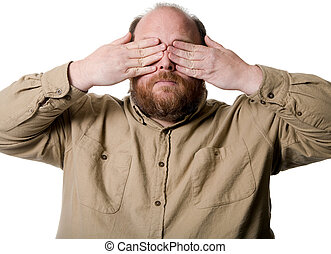 See no evil - Man with hands over his eyes