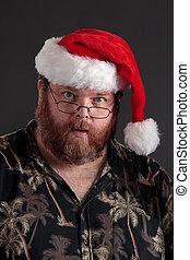 Obese man in Santa Hat