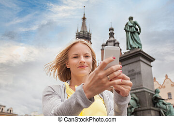 Young beautiful woman on the background of the St. Mary's...