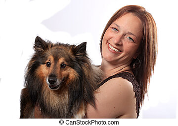 Woman and furry dog
