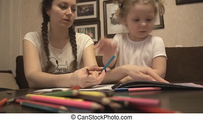 Mother and daughter coloring leaf