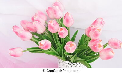 Spring pink and white tulips in the interior