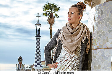 woman at Guell Park in Barcelona, Spain looking into...