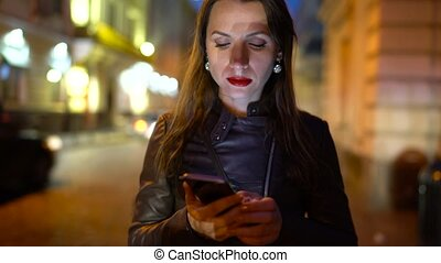 Woman with red lips talking on the smartphone and strolls...