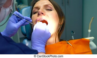 Closeup woman getting a dental treatment - Close up woman...