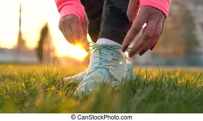 Running shoes - woman tying shoe laces. Closeup of female...