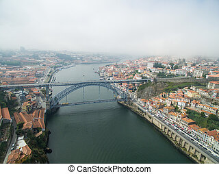 Panoramic view of the old city of Porto. One flew over the...