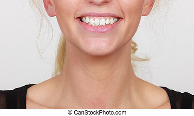 Happy smiling woman showing white teeth