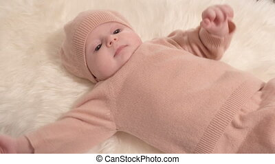 Little girl on fur cloth - Little girl baby on white furl...