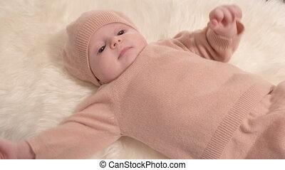 Little girl on fur cloth - Little girl baby on white furl...